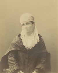 Studio portrait of a Ottoman woman wearing a yashmak